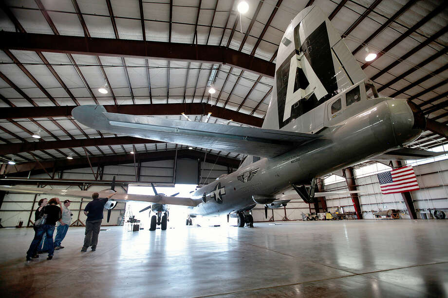 Onlookers marvel at a B-29 airplane Sept. 12 at the Commemorative Air Force's museum in Midland. San Antonio is on a short list of communities being considered for the group's national headquarters. Photo: AP