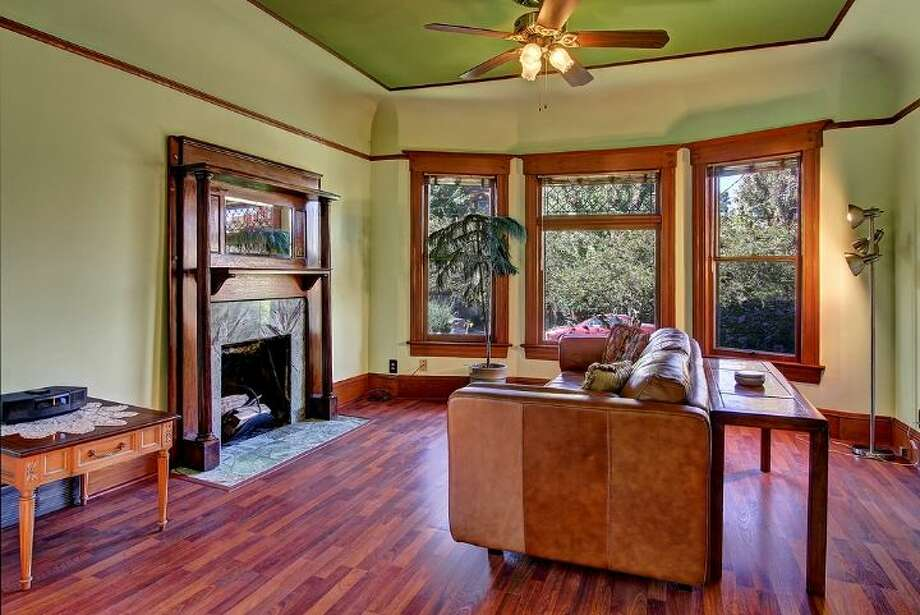 Living room of 418 10th Ave. E.of  It's listed for $789,999, although a sale is pending. Photo: Courtesy Erick Hazelton, Windermere Real Estate