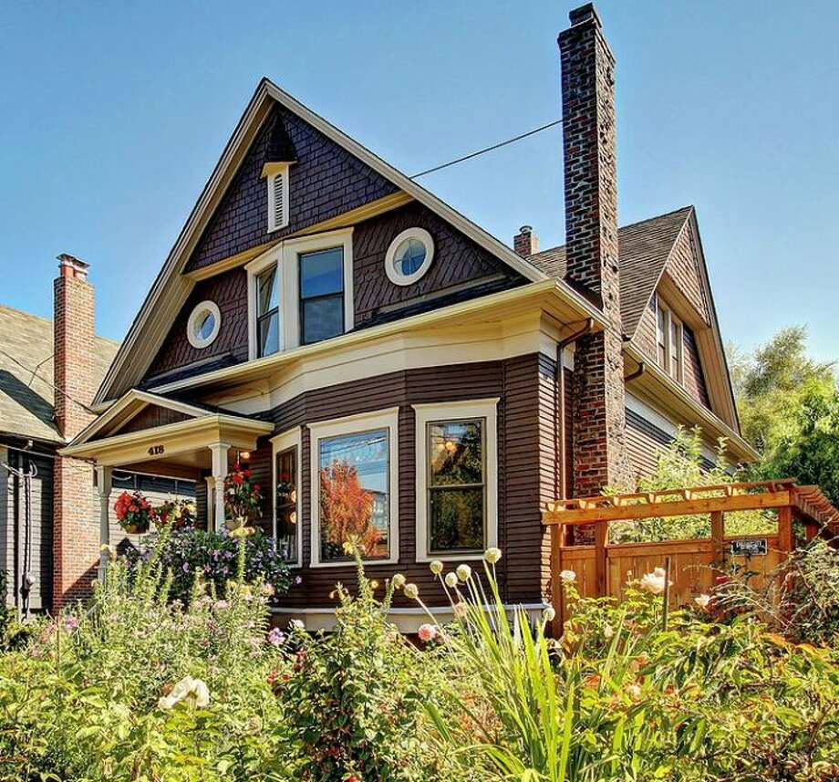 Capitol Hill is where many Seattleites would buy a home if they had $750,000 to $800,000 to spend. Here are some examples of what you could get there for that amount, starting with 418 10th Ave. E. The 2,440-square-foot Victorian, built in 1908, has three bedrooms, 1.75 bathrooms, exposed wood moldings, coved, 12-foot ceilings and a den on a 4,000-square-foot lot with a greenhouse. It's listed for $789,999, although a sale is pending. Photo: Courtesy Erick Hazelton,  Windermere Real Estate