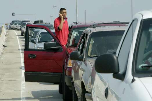 An evacuee talks on his cell phone as traffic crawls along the Katy Freeway as Hurricane Rita approaches the Texas Gulf Coast Thursday, Sept. 22, 2005, in Houston. Photo: Kevin Fujii, Houston Chronicle / Houston Chronicle