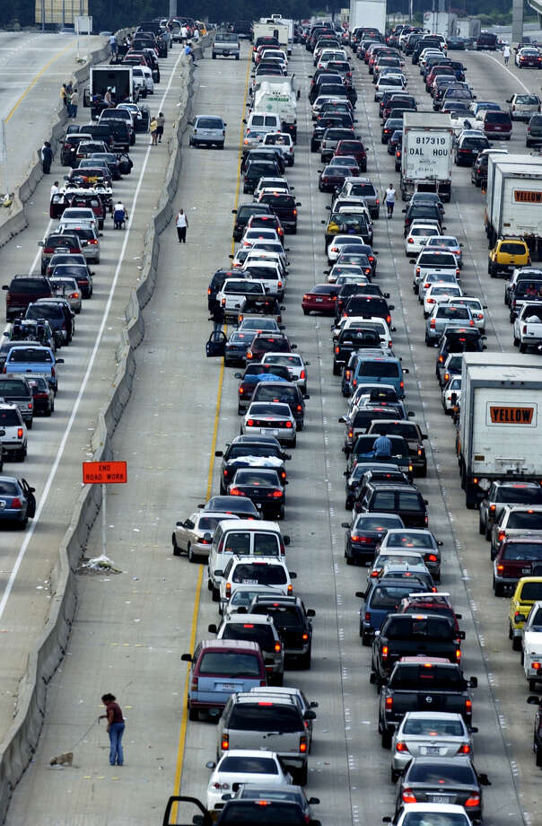"Longer commutesPeople are experiencing longer commutes to work due to traffic. The report notes that on average, commuters are sitting in traffic for ""the equivalent of five vacation days.""Source: Department of Transportation Photo: Ben DeSoto, Houston Chronicle / Houston Chronicle"