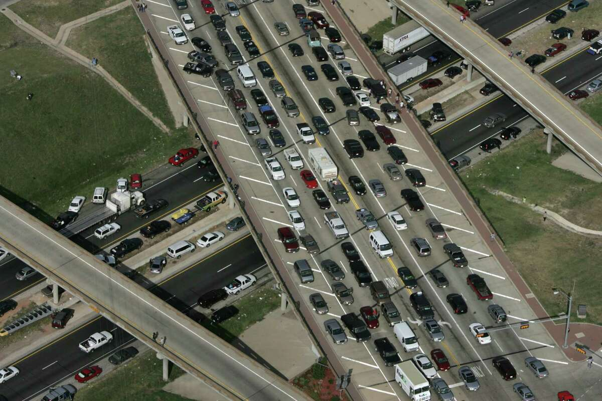 Cars jam interstate 45 and cross streets during the evacuation from Hurricane Rita Friday, Sept. 23, 2005, near Ennis, Texas. (Photo by Brett Coomer/Houston Chronicle) HOUCHRON CAPTION (10/06/2005) SECNEWS COLORFRONT: PARKING LOT: Hurricane Rita evacuees jam Interstate 45. About 96 percent of evacuees fled by car, and 18 percent of them headed north on I-45, making it the area's most-used freeway during the flight to safety. HOUCHRON CAPTION (10/17/2005) SECMETRO COLORFRONT: Officials offer ideas on controlling traffic bottlenecks like those during the Hurricane Rita evacuation.
