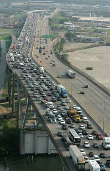 Traffic is lined up on the East Loop over the Houston Ship Channel fleeing in preparation for the possible landfall of Hurricane Rita Tuesday, Sept. 21, 2005, in Houston. Photo: BRETT COOMER, HOUSTON CHRONICLE / HOUSTON CHRONICLE