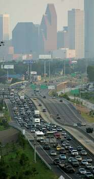 Traffic is lined up on I-45 North fleeing in preparation for the possible landfall of Hurricane Rita Tuesday, Sept. 21, 2005, in Houston. Photo: BRETT COOMER, HOUSTON CHRONICLE / HOUSTON CHRONICLE