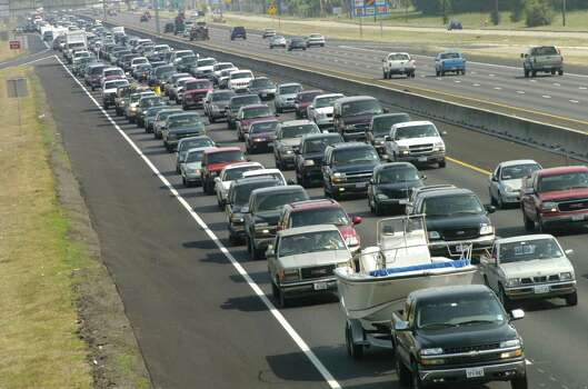Lines of cars leaving the Galveston area on 45 the Gulf Frwy, as people  evacuated. Photo by   Carlos Antonio Rios/Houston Chronicle. Photo: Carlos Antonio Rios, Houston Chronicle / Houston Chronicle