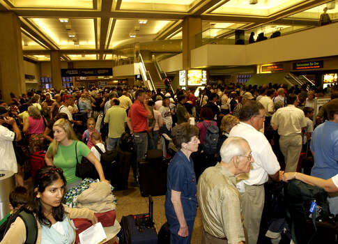 Hundreds fill the Concourse of Terminal C, Continental Airlines check-in at the Bush Intercontinental Airport,  Thursday Sept. 22, 2005. Freeways have been bumper to bumper with vehicles leading away from Houston since sunset the night before. (Chronicle/Ben DeSoto) Photo: Ben DeSoto, Houston Chronicle / Houston Chronicle