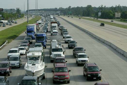 Traffic crawls along I-45 north bound to escape the wrath of Hurricane Rita on Sept. 21, 2005, in The Woodlands. Rita was forecast to hit the Texas Gulf Coast as a Category 5 storm but moved east. (Kevin Fujii/Chronicle) Photo: Kevin Fujii, Houston Chronicle / Houston Chronicle