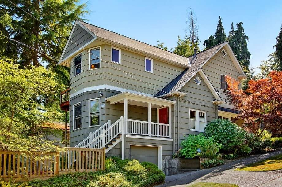 Next comes 621 27th Ave. E. The 2,540-square-foot house, built in 1908, has four bedrooms, 2.5 bathrooms, high ceilings, media room, a balcony and a deck on a 3,400-square-foot lot. It's listed for $774,900. Photo: Vista Estate Imaging, Jacob Pickett, Keller Williams Greater Seattle Realty