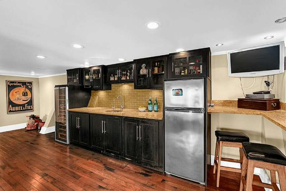 Media room wet bar of 2448 Delmar Drive E. It's listed for $799,000. Photo: Courtesy Steve Leland, Windermere Real Estate