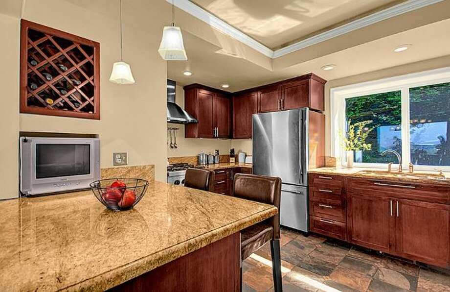 Kitchen of 2448 Delmar Drive E. It's listed for $799,000. Photo: Courtesy Steve Leland, Windermere Real Estate