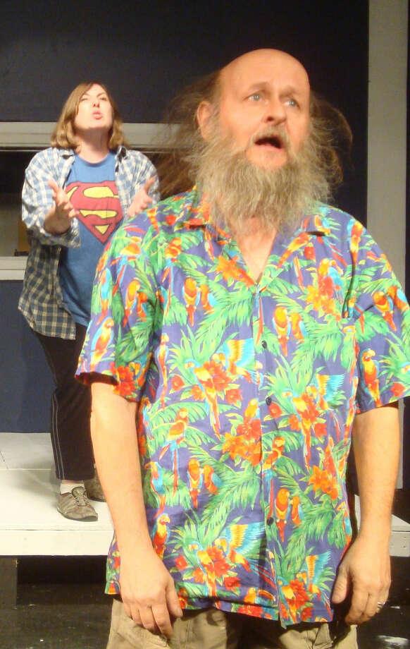 "Rachel Joseph (left) and Chris Champlin rehearse a scene from ""The Haunted House."" Photo: Courtesy Thomas E. Jenkins"