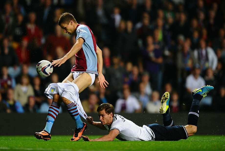 C'mon maaaaaaaaan:Jan Verttonghen of Tottenham Hotspur hangs on to the shorts of Nicklas Helenius of Aston Villa during the Capital One Cup third round match between Aston Villa and Tottenham Hotspur at Villa Park in Birmingham, England. Photo: Laurence Griffiths, Getty Images