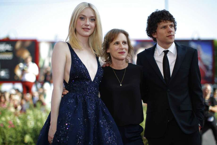 "Actress Dakota Fanning (from left), director Kelly Reichardt and actor Jesse Eisenberg appear on the red carpet for a screening of the film ""Night Moves."" Photo: Andrew Medichini / Associated Press"