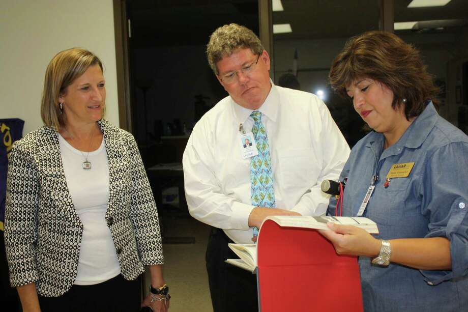Terry High School principal Vera Wehring escorts executive director of secondary education Walter Bevers and Lamar CISD Board of Trustees member Anna Gonzales on the first day of school. Photo: Provided By Terry High School
