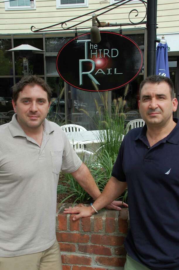 Michael DeAddio, right, and his brother, Stuart, have opened The Third Rail at 22 Center St. in Darien. Jarret Liotta/For the Darien News Photo: Contributed
