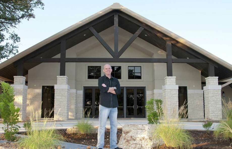Randy Ayres, lead pastor of Cross Mountain Church, stands in front of a new worship center set to open Oct. 6.