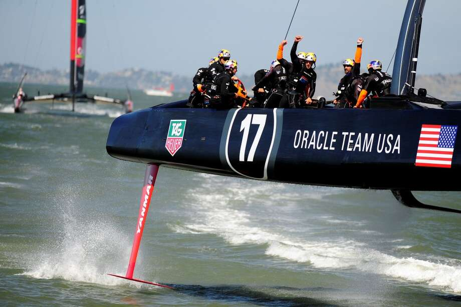 Oracle Team USA celebrates after winning race 17. Photo: JOSH EDELSON, AFP/Getty Images