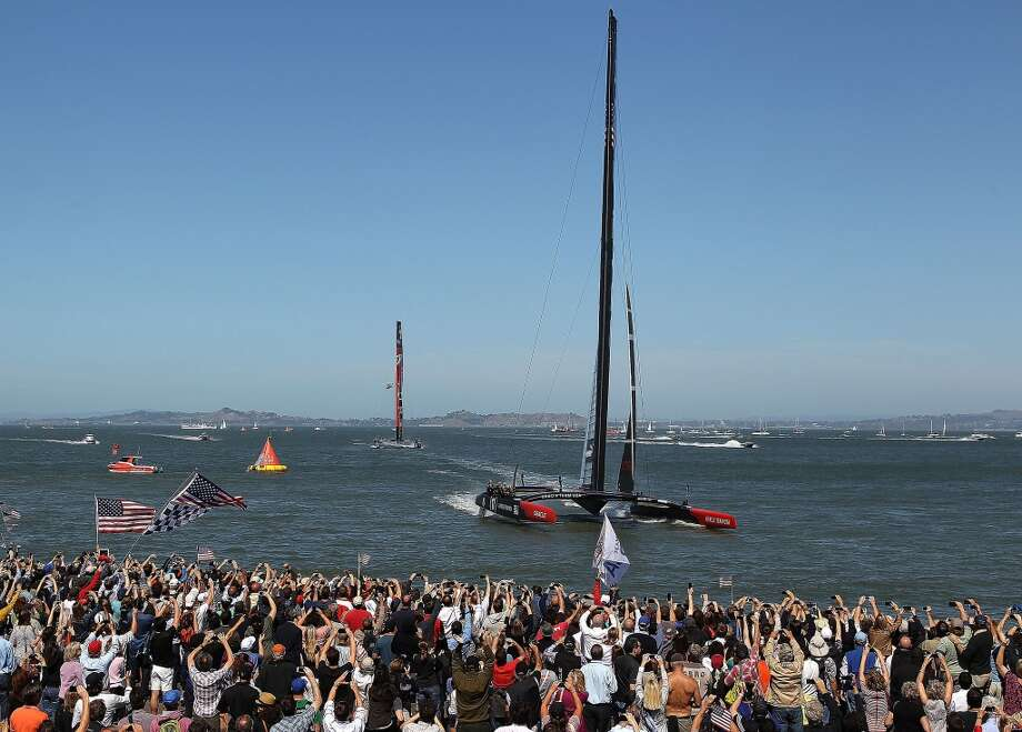 Oracle Team USA skippered by James Spithill crosses the finish line ahead of Emirates Team New Zealand. Photo: Jed Jacobsohn, Getty Images