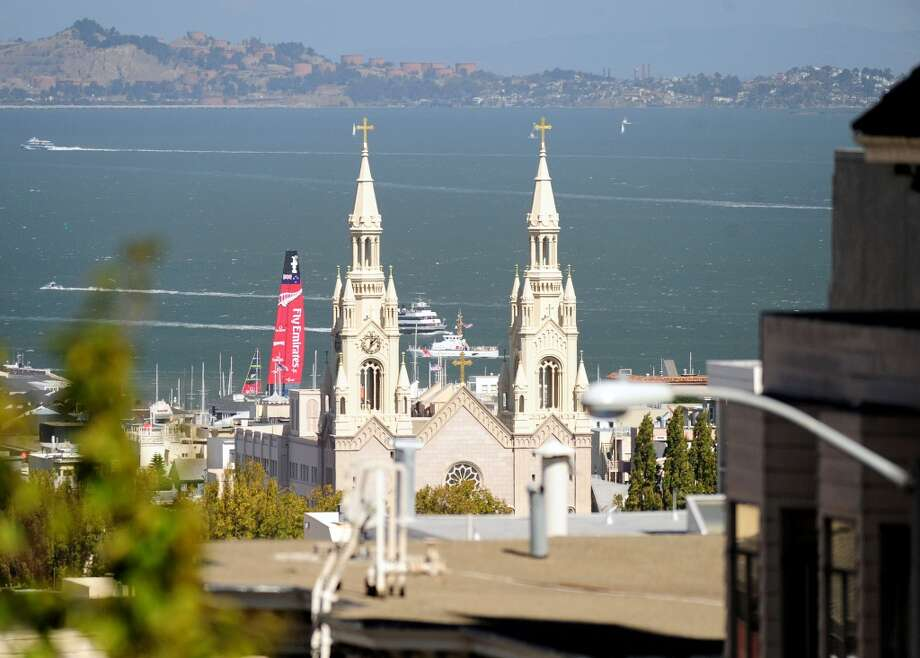 Emirates Team New Zealand sails near the Saints Peter and Paul Church before the start of race 17 of the 34th America's Cup. Photo: JOSH EDELSON, AFP/Getty Images