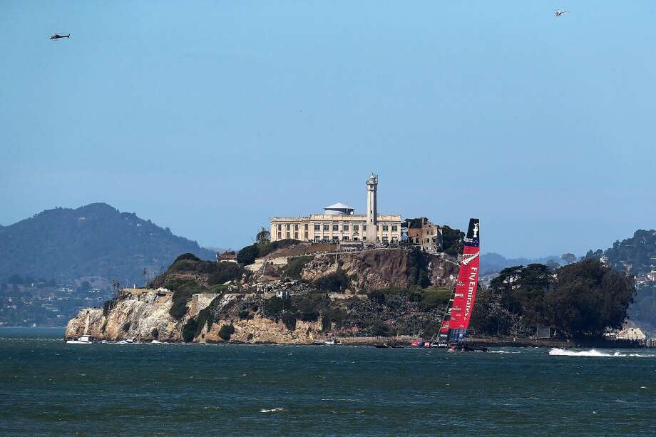 Emirates Team New Zealand skippered by Dean Barker in action against Oracle Team USA. Photo: Jed Jacobsohn, Getty Images