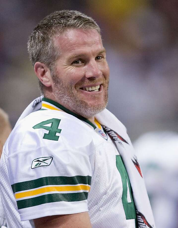ST. LOUIS, MO - DECEMBER 16: (FILE PHOTO) Brett Favre #4 of the Green Bay Packers laughs while on the sideline against the St. Louis Rams at the Edward Jones Dome December 16, 2007 in St. Louis, Missouri. It was reported that quarterback Brett Farve was traded to the New York Jets on August 6, 2008. (Photo by Dilip Vishwanat/Getty Images) Photo: Dilip Vishwanat, Getty Images