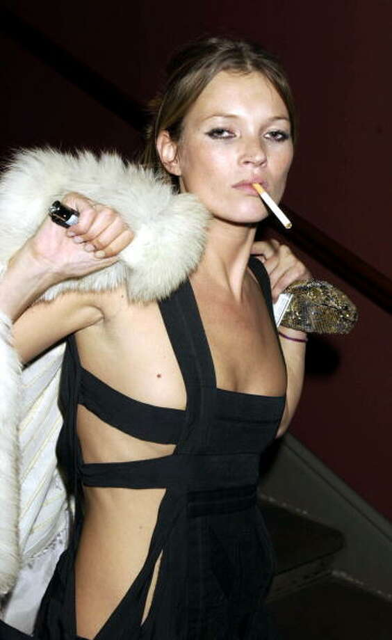 One of many Kate Moss cigarette photos (2003). Photo: Dave Benett, Getty Images / Hulton Archive
