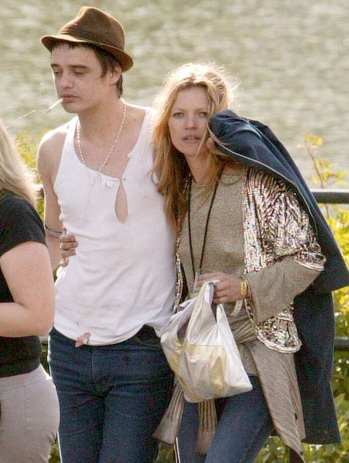 Kate Moss with musician boyfriend Pete Doherty in 2005. Doherty's frequent scuffles and drug arrests made him and Moss a regular feature in British tabloids.