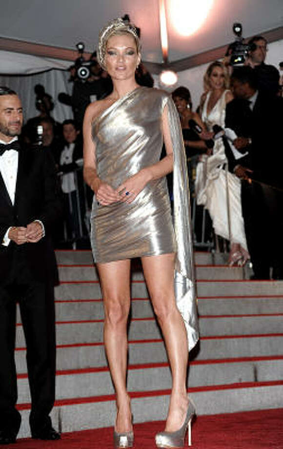Looking a little drag queen in a cape, turban and gold mini-toga. It's Kate Moss in Marc Jacobs at the Costume Institute Gala in 2009 in New York. Photo: Evan Agostini, AP / Evan Agostini, AP