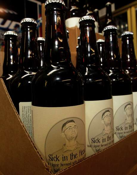 Sick in the Head, a Belgian strong golden ale by Spec's Joey Williams and Buffalo Bayou Brewing's Ryan Robertson, is a tribute to Williams. Each bottle sells for $9.99, and a portion of sales goes to rare-cancer research. Photo: Cody Duty, Staff / © 2013 Houston Chronicle