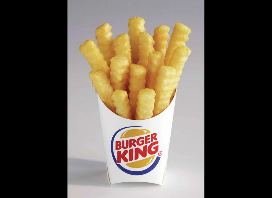 """This undated image provided by Burger King, shows the new french fry that the company says has 20 percent fewer calories than its regular fries. The """"Satisfries"""" will cost about 30 cents more than its regular fries. (AP Photo/Burger King, Noel Barnhurst)  ORG XMIT: NYBZ119 Photo: Noel Barnhurst / Burger King"""