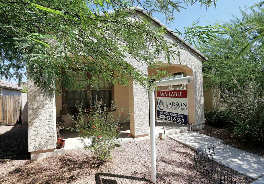 FILE - In  this Tuesday, July 30, 2013, file photo, a realty sign hangs in front of a home for sale in Gilbert, Ariz. Standard & Poor's/Case-Shiller reports on home prices in July on Tuesday, Sept. 24, 2013.  (AP Photo/Matt York, File) ORG XMIT: NYBZ122 Photo: Matt York / AP