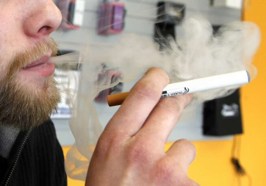 Electronic cigarettes emit vapor, not smoke, but their rising popularity could mean the U.S. Food and Drug Administration might end up regulating them as strictly as regular smokes. Photo: Ed Andrieski, Associated Press