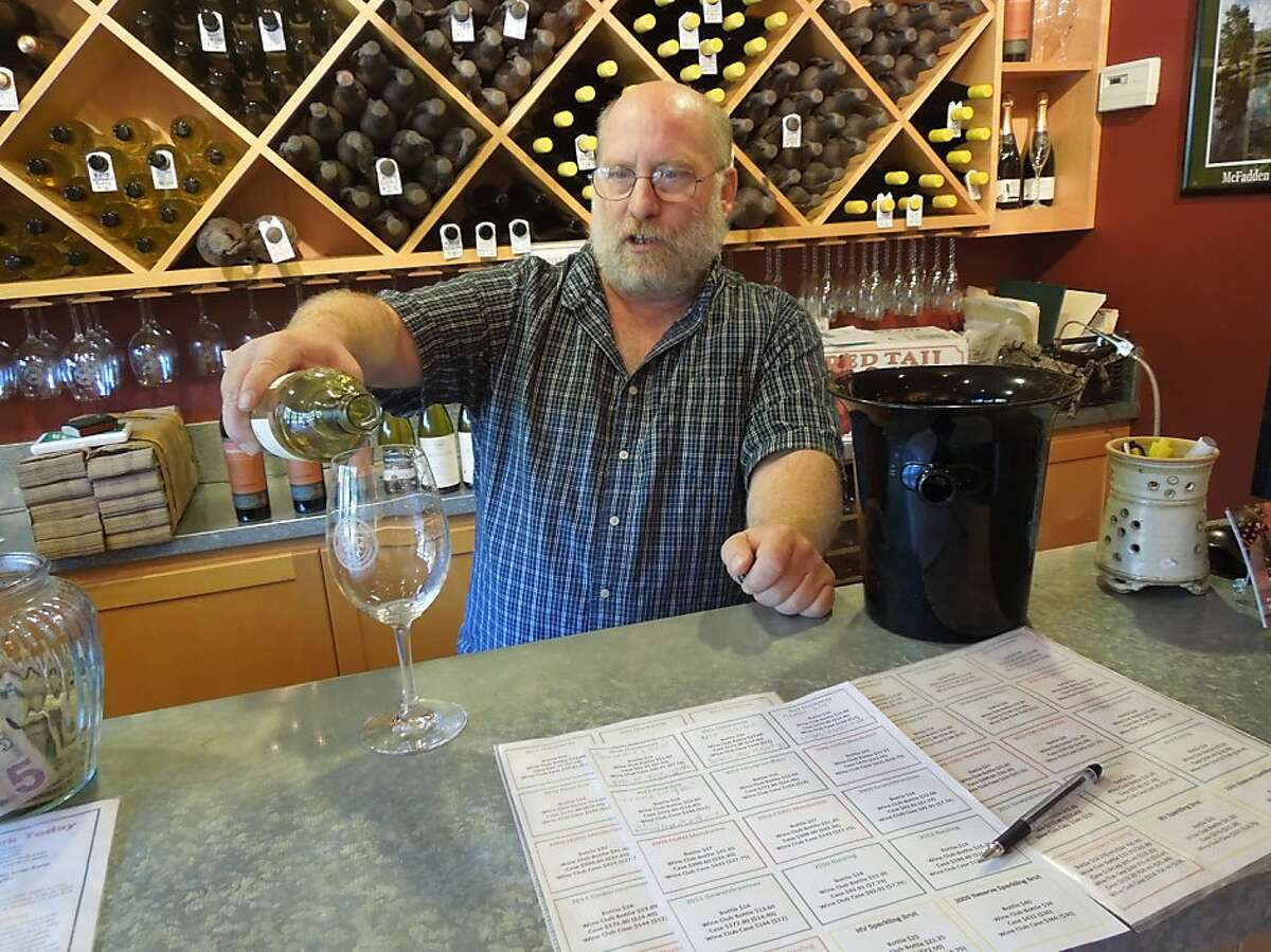 Tasting room manager John Cesano pours wine at McFadden Farm Stand & Tasting Room in Hopland, Mendocino County.