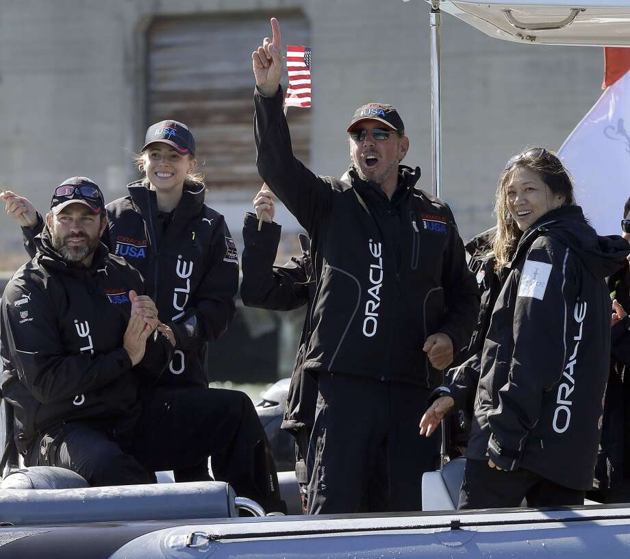 Oracle CEO Larry Ellison, center right, gestures after Oracle Team USA won the 18th race of the America's Cup sailing event against Emirates Team New Zealand. Photo: Ben Margot, Associated Press