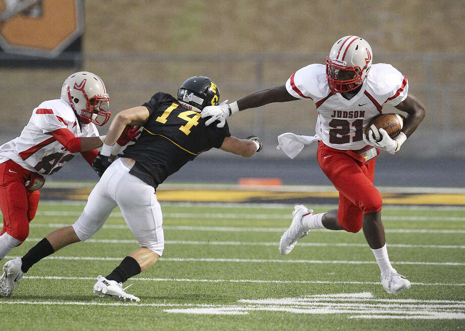 Judson's Cedric Williams (21) pushes away East Central's Russell Brown (14) during their game at East Central Friday. Judson won in a rout, 49-7.