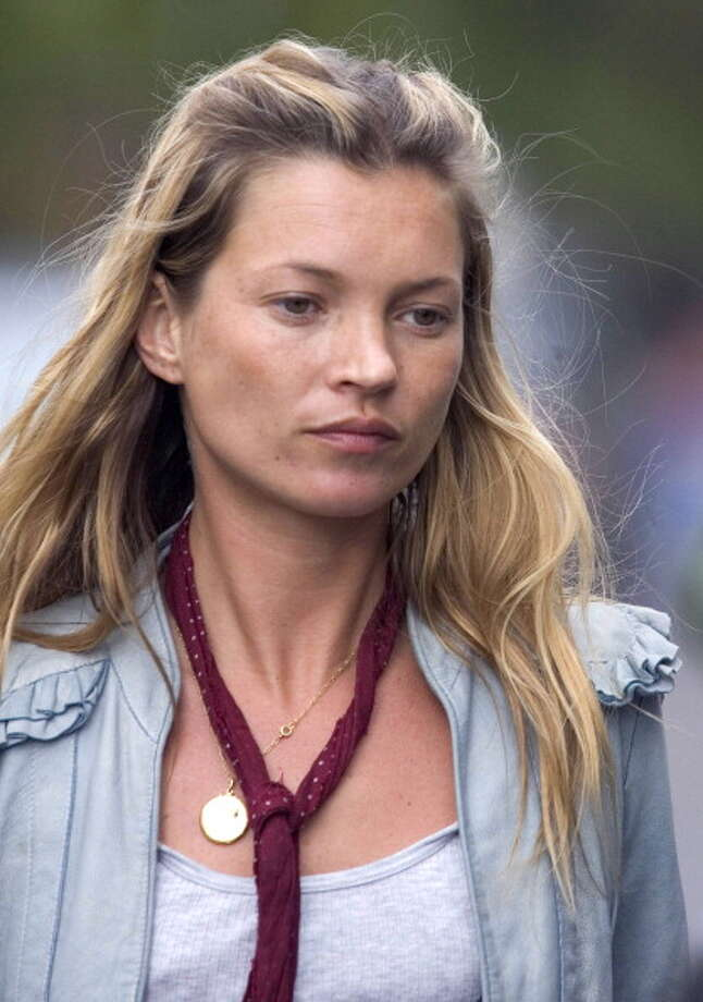 Kate Moss is pictured in 2005, the year The Daily Mirror ran photos of her snorting cocaine. That caused Moss to lose  contracts with H&M, Chanel and other companies. She rebounded a year later, with campaigns with Burberry and other top designers. Photo: Antony Jones, UK Press Via Getty Images / UK Press