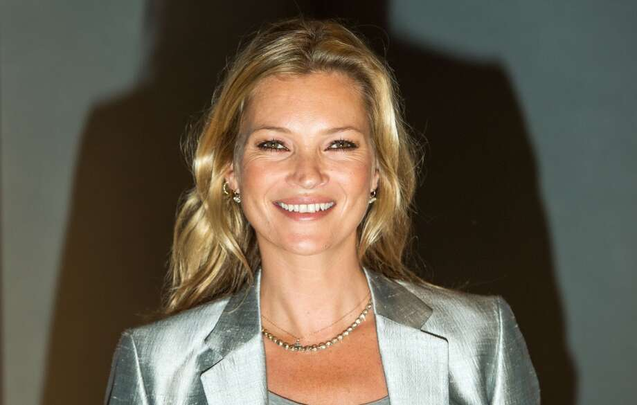 "Kate Moss on Sept. 4, 2013. She's posing at the London auction of ""Kate Moss: The Collection,"" which is a bunch of photos and paintings that feature her famous face and body. Photo: Samir Hussein, Getty Images / Getty Images"