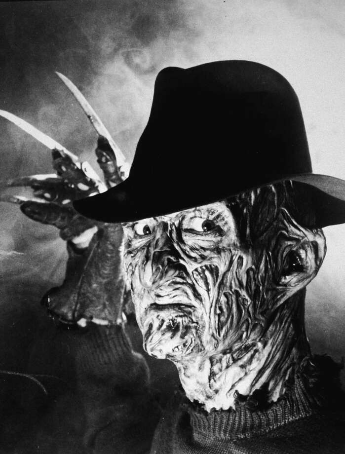 """15. """"A Nightmare on Elm Street""""(1984)   This movie was praised for its special effects and inventive plot when it came out. But when Freddy Krueger began appearing in endless sequels, it was time for the boogeyman to retire the claws and ugly striped sweater. Photo: Hulton Archive, Getty Images / 2004 Getty Images"""