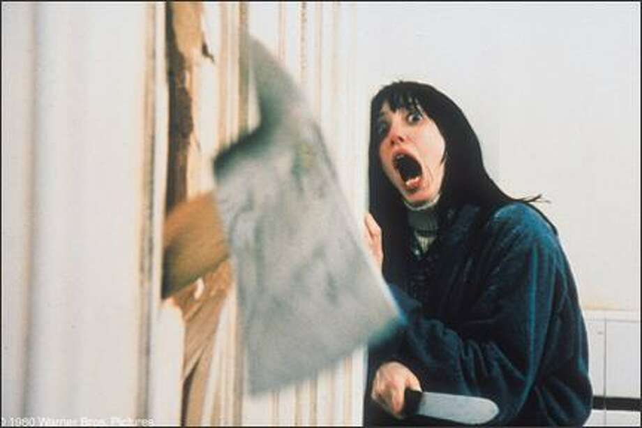 """18. """"The Shining""""(1980):   Stanley Kubrick's masterful horror treatment on wintry isolation, madness, torrents of blood, and creepy girl ghosts. Photo: Warner Bros. Pictures"""