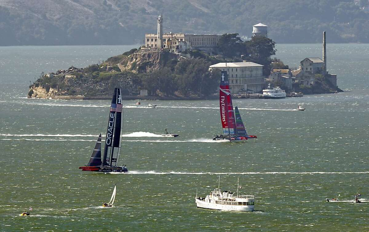 Oracle Team USA rounds mark 4 and heads to the finish line in race 18 over Emirates Team New Zealand to take race 18 and tie the score at 8-8 as the America's Cup continues on San Francisco Bay, Calif., on Tuesday Sept. 24, 2013.
