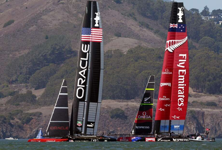 Oracle Team USA and Emirates Team New Zealand get close to each other at the start of Race 17 of the America's Cup Finals on Tuesday, September 24, 2013 in San Francisco, Calif. Photo: Beck Diefenbach, Special To The Chronicle