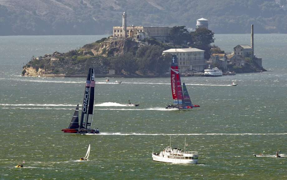 Oracle Team USA rounds mark 4 and heads to the finish line in race 18 over Emirates Team New Zealand to take race 18 and tie the score at 8-8 as the America's Cup continues on San Francisco Bay, Calif., on Tuesday Sept. 24, 2013. Photo: Michael Macor, The Chronicle