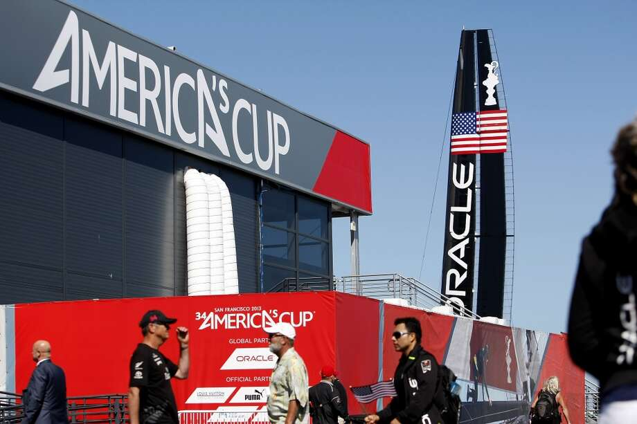 Oracle Team USA's AC72 passes by the America's Cup Park before the start of race 17 of the America's Cup Finals in San Francisco, CA Tuesday September 24, 2013. Photo: Michael Short, The Chronicle