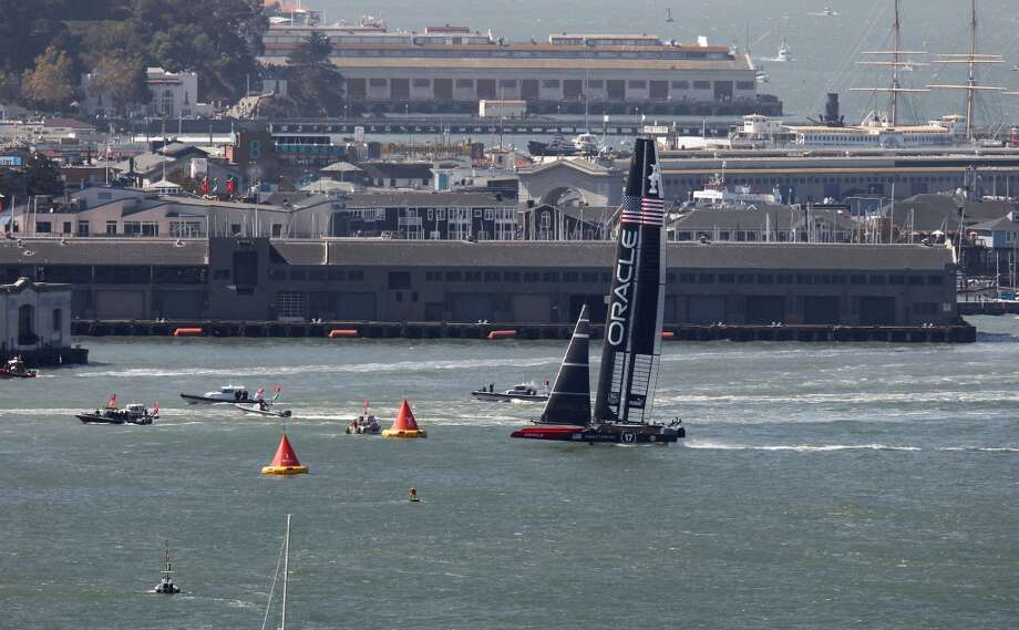 Crossing the finish line Oracle Team USA takes race 17  over Emirates Team New Zealand as the America's Cup continues on San Francisco Bay, Calif., on Tuesday Sept. 24, 2013. Photo: Michael Macor, The Chronicle