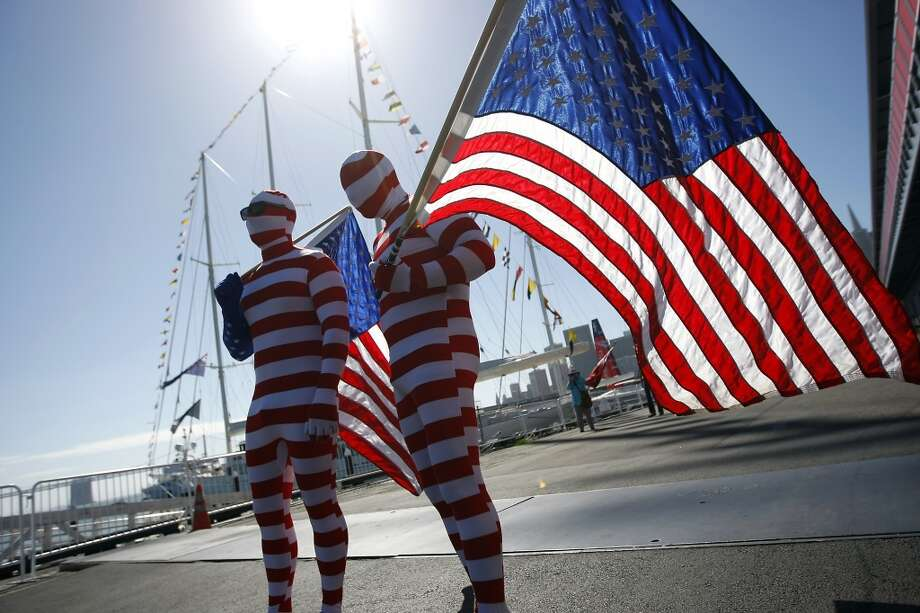 Chuck Anderson, left, of Australia and Aaron Toresen of New Zealand are seen dressed in American flag body suits in support of Oracle Team USA before the start of race 17 of the America's Cup Finals in San Francisco, CA Tuesday September 24, 2013. Photo: Michael Short, The Chronicle