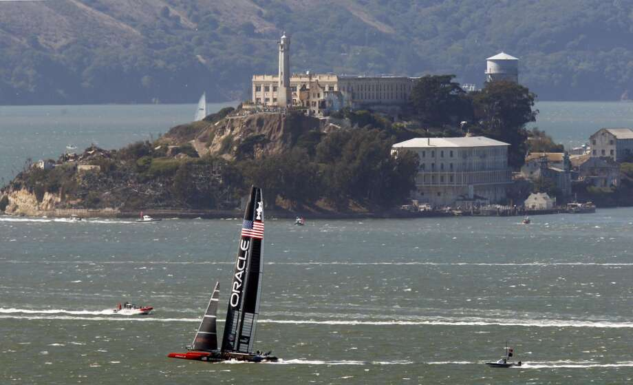 Oracle Team USA heads upwind after rounding mark 2 in race 18 ahead of Emirates Team New Zealand as the America's Cup continues on San Francisco Bay, Calif., on Tuesday Sept. 24, 2013, with USA going on to win and tie the score at 8-8. Photo: Michael Macor, The Chronicle