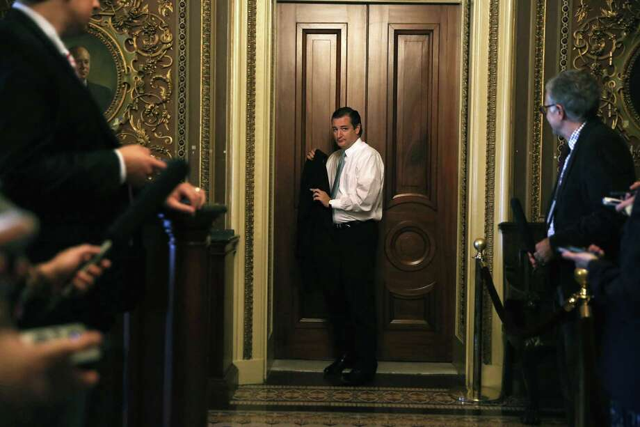 Sen. Ted Cruz, R-Texas, gave a marathon speech designed to force the Senate to defund the Affordable Care Act or shut down the government. Because of Senate rules, the speech could not be considered a filibuster. Photo: Alex Wong, Getty Images / 2013 Getty Images