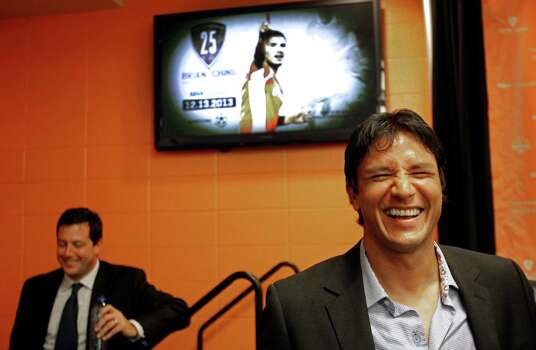Houston Dynamo president Chris Canetti is shown left as Houston Dynamo forward Brian Ching, right, shares a laugh with members of the media after a media conference about his retirement held at BBVA Compass Stadium Tuesday, Sept. 24, 2013, in Houston. The Houston Dynamo and Dynamo Charities will host a Brian Ching Testimonial Match on Dec. 13. The event will benefit, The House That Ching Built, which is Ching's  partnership with Houston Habitat for Humanity. Photo: Melissa Phillip, Houston Chronicle / © 2013  Houston Chronicle