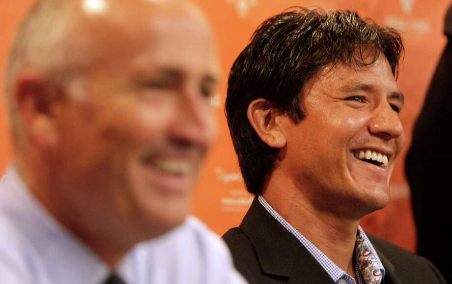Houston Dynamo coach Dominic Kinnear, left, and player Brian Ching, right, share a laugh as they talk during a media conference about Ching's retirement at BBVA Compass Stadium Tuesday, Sept. 24, 2013, in Houston. The Houston Dynamo and Dynamo Charities will host a Brian Ching Testimonial Match on Dec. 13. The event will benefit, The House That Ching Built, which is Ching's  partnership with Houston Habitat for Humanity. Photo: Melissa Phillip, Houston Chronicle / © 2013  Houston Chronicle