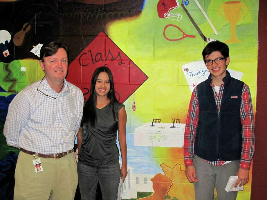 From left: Mark Phillips, Alejandra Zamora and Juan Rivera, of the New Canaan High School Model U.N. club. Sept. 17, 2013. New Canaan, Conn. Photo: Tyler Woods